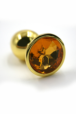 Золотая анальная пробка с ярко-оранжевым кристаллом (Small)