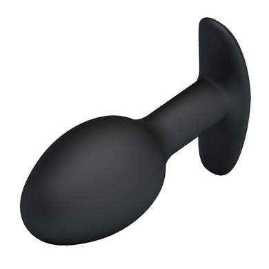 Анальная пробка черного цвета со смещенным центром тяжести